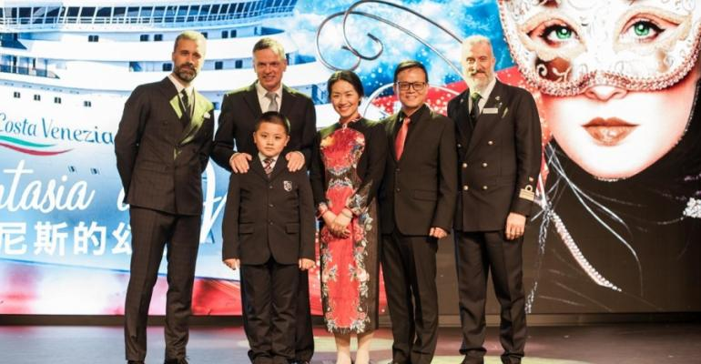 Godmother Gan Beiye and her family on stage in the Teatro Rosso with, from left, Costa Asia's Mario Zanetti, Costa Group/Carnival Asia's Michael Thamm and Costa Venezia Capt. Giulio Valestra FILE PHOTO: Costa Cruises