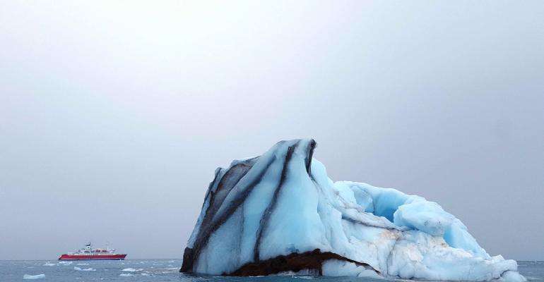 MV Expedition & iceberg (photo - AECO)