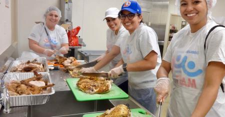 Carnival F.U.N. Team turkey carving for Camillus House.jpg